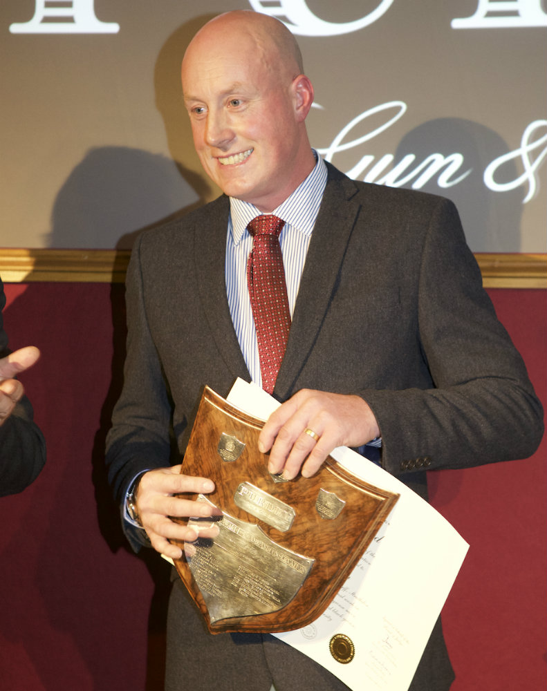 Neil Brown collecting the award